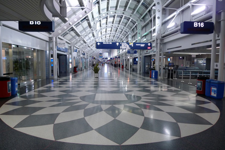 Large Depth of Field with a short lens on a small sensor camera.  An Empty O'Hare airport terminal, Chicago, Illinois, March 2009.  Panasonic LX-3, 5.1mm lens, 1/20th at f/2, ISO 200.  Photo by Matthew Cole.