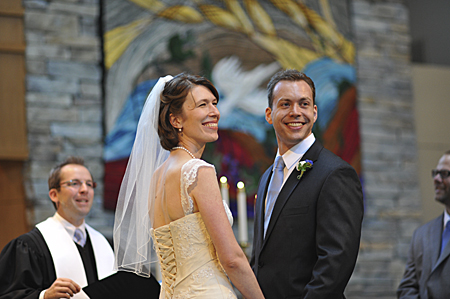 Narrow depth of field with a longer lens.  Friends getting married, Church of the Resurrection, Leawood, Kansas, June 2012.  Nikon D700, 135mm f/2 DC lens, 1/320th at f/2, ISO 1600.  Photo by Matthew Cole.
